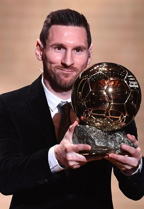 Barcelona's Argentinian forward Lionel Messi reacts after winning the Ballon d'Or France Football 2019 trophy at the Chatelet Theatre in Paris on December 2, 2019. - Lionel Messi won a record-breaking sixth Ballon d'Or on Monday after another sublime year for the Argentinian, whose familiar brilliance remained undimmed even through difficult times for club and country. (Photo by FRANCK FIFE / AFP) (Photo by FRANCK FIFE/AFP via Getty Images)
